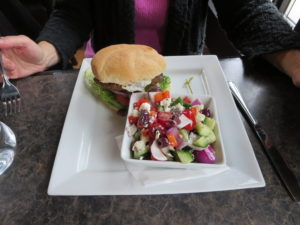 Lamb burger with a greek salad